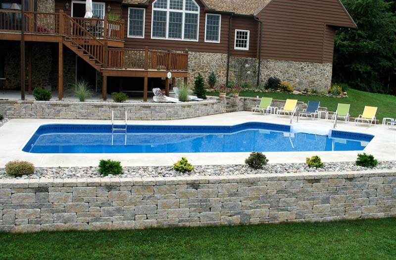 Retaining walls from george neiderer custom pools of for Pool design retaining wall